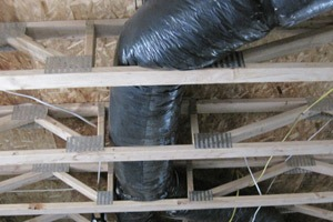 Duct in open web trusses