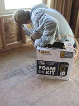 Applying air sealing foam insulation